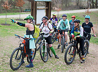 NWA Democrat-Gazette/CHARLIE KAIJO Becci Neal of Bentonville (left) leads a group of all-women bike riders, Friday, March 23, 2018 that started at the Record and ended at Slaughter Pen Trail in Bentonville. <br /><br />The International Mountain Biking Association held an event called Uprising to try and increase female participation in mountain biking. The group did a trail ride at Slaughter Pen leaving from the Record