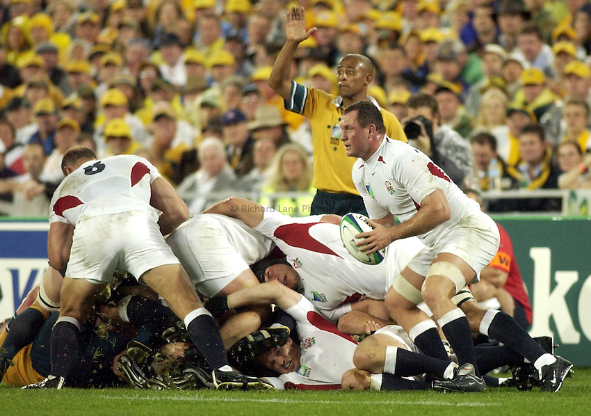 Photo: Steve Holland..Australia v England. Rugby World Cup Final, at the Telstra Stadium, Sydney. RWC 2003. 22/11/2003. .Richard Hill collects the ball.