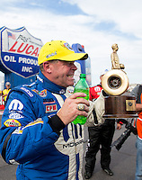 Feb 23, 2014; Chandler, AZ, USA; NHRA pro stock driver Allen Johnson celebrates after winning the Carquest Auto Parts Nationals at Wild Horse Pass Motorsports Park. Mandatory Credit: Mark J. Rebilas-USA TODAY Sports