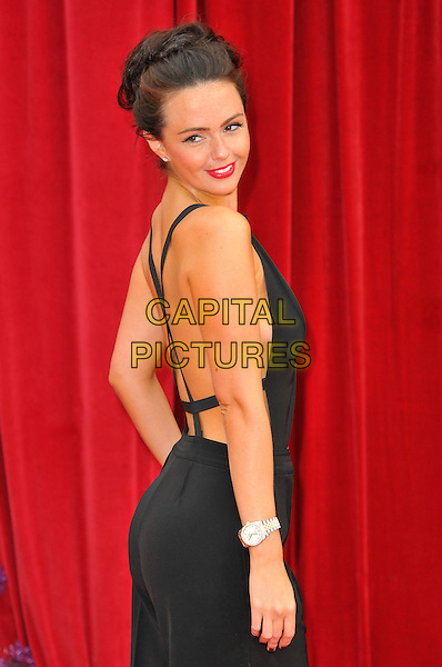 JENNIFER METCALFE .Attending the British Soap Awards 2011, .Granada Television Studios, Quay Street, Manchester, England, UK, .March 14th 2011..arrivals half length Side back over shoulder black rear behind catsuit pantsuit straps hair up .CAP/CAS.©Bob Cass/Capital Pictures.