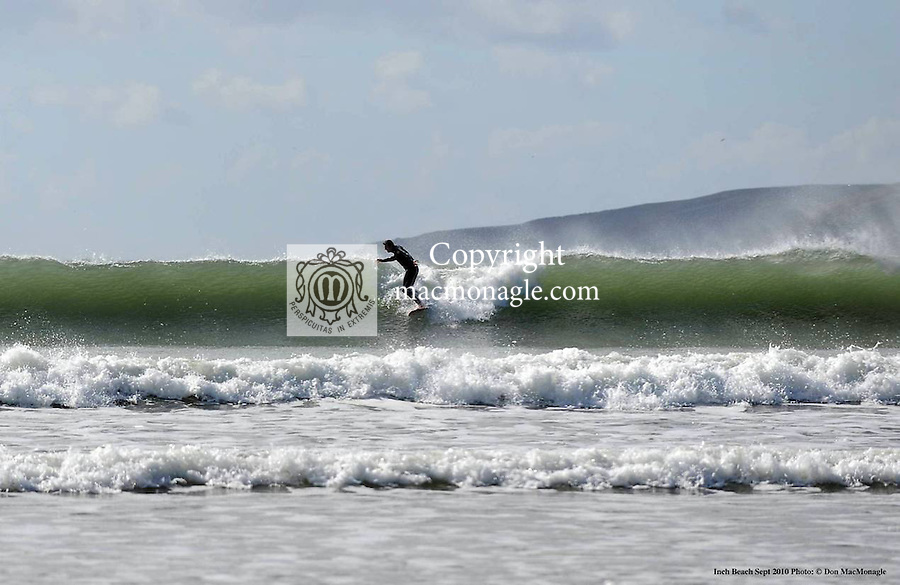 Surfers enjoy high waves and late warm September sunshine at Inch Strand in County Kerry..Picture by Don MacMonagle