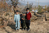 "Boy with toy gun and ""Indian"" uniform, with friends. Dardpora is a village where many has died as a result of fighting between Indian military and Kashmiri separatists. Kashmir, India. © Fredrik Naumann/Felix Features"