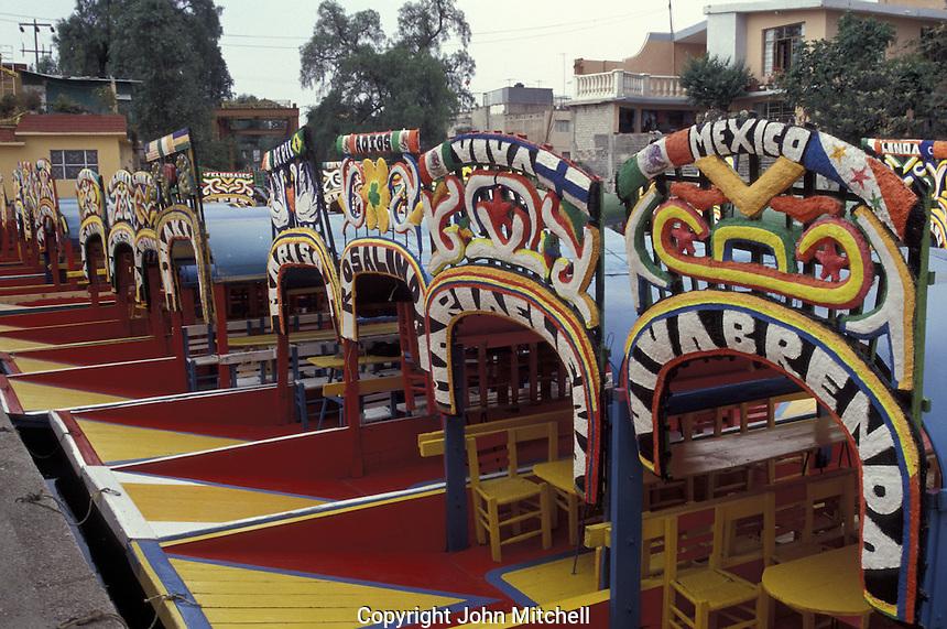 Trajineras docked at an embarcadero in Xochimilco, Mexico City.