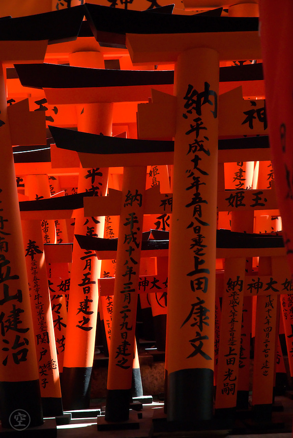 """Detail of small red torii gates at Fushimi Inari Shrine, Kyoto. The shrine is better known for its """"tunnel"""" of vermilion torii gates."""