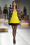 Model walks runway in a violet brocade BERTRAND jacket with peplum and zipper detail, yellow silk tulle FREDRICO dress with tube style straps Black silk tulle DANIELE crinoline with sequin trim, from the Greta Constantine Spring Summer 2018 collection by Kirk Pickersgill and Stephen Wong on September 6, 2017; at Pier 59 Studios during New York Fashion Week.
