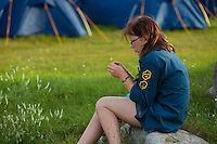 Swedish scout on a stone by her self. Photo: Magnus Fröderberg/Scouterna