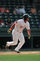 Third baseman Rafael Devers (13) of the Greenville Drive bats in a game against the Savannah Sand Gnats on Saturday, September 5, 2015, at Fluor Field at the West End in Greenville, South Carolina. (Tom Priddy/Four Seam Images)
