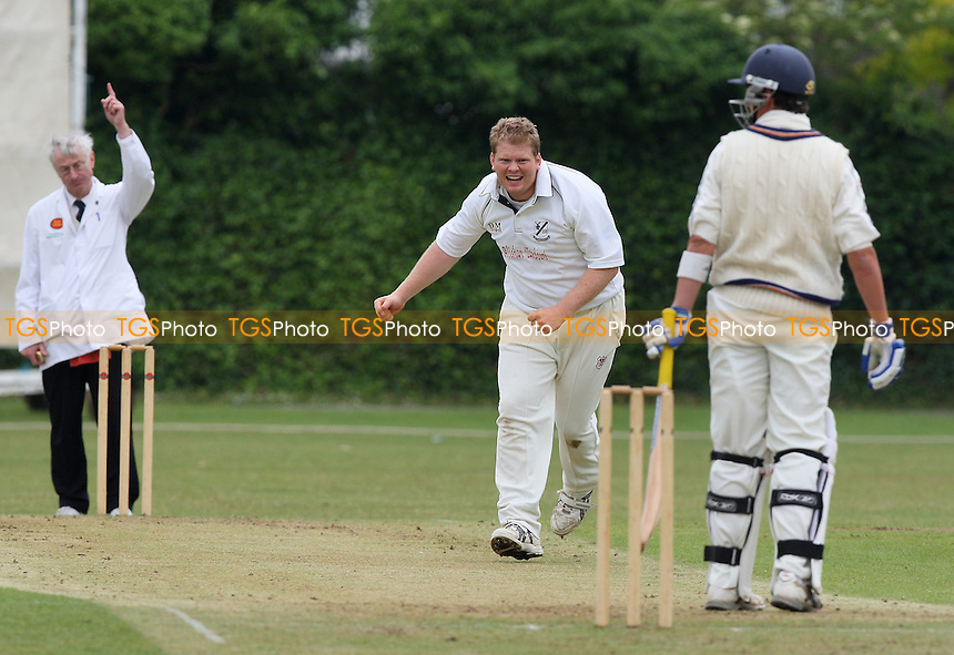 Nick O'Dell of Upminster claims the wicket of Woodford Wells batsman Mark Richardson - Upminster CC vs Woodford Wells CC - Essex Cricket League - 06/06/09 - MANDATORY CREDIT: Gavin Ellis/TGSPHOTO - Self billing applies where appropriate - 0845 094 6026 - contact@tgsphoto.co.uk - NO UNPAID USE.