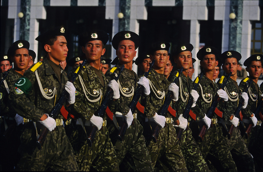 Ashgabat, Turkmenistan, October 1997..The Turkmen military parade in front of President Saparmurat Niyazov's $100M Presidential Palace. Poverty-stricken, but rich in oil and gas resources, this Central Asian former Soviet republic is ruled by the autocratic President Saparmurat Niyazov, or Turkmenbashi as he has renamed himself..............Hollandse Hoogte