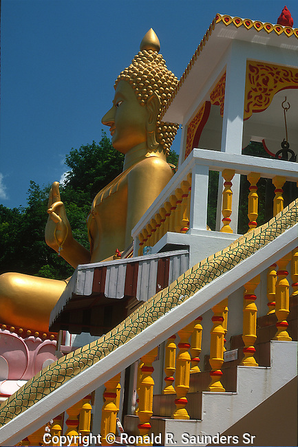 GIANT GOLDEN BUDDHA AT TEMPLE IN PHUKET THAILAND