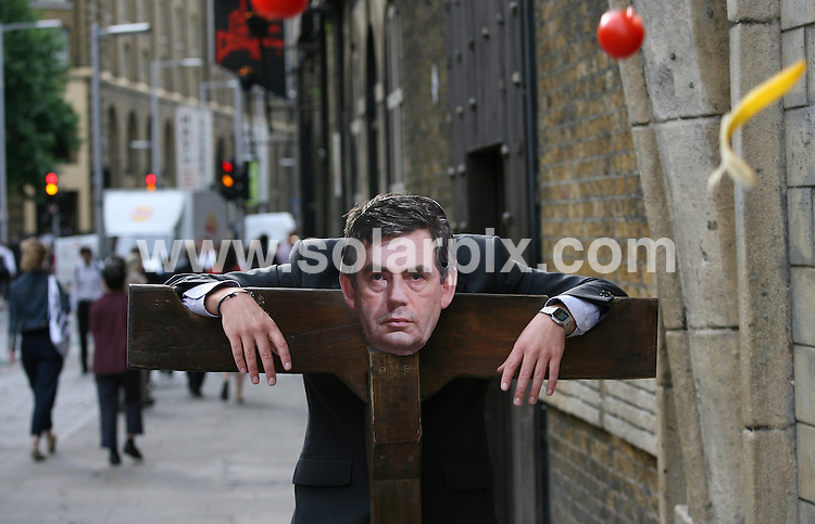 """**ALL ROUND PICTURES FROM SOLARPIX.COM**.**WORLDWIDE SYNDICATION RIGHTS**.a likeness of the UK's PM Gordon Brown is pelted with vegetables after a poll of visitors to the London Dungeons attraction found him the most deserving """"Modern Day Villain"""". Southwark, London, UK. 6 August 2009..This pic: Gordon Brown..JOB REF: 9708 LNJ     DATE: 06_08_2009.**MUST CREDIT SOLARPIX.COM OR DOUBLE FEE WILL BE CHARGED**.**MUST NOTIFY SOLARPIX OF ONLINE USAGE**.**CALL US ON: +34 952 811 768 or LOW RATE FROM UK 0844 617 7637**"""