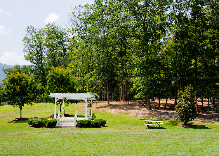 A gazebo in the lawn is often used for weddings and picnic tables up in the woods beyond are popular for enjoying a picnic or just a glass of wine.  (At Veritas Vineyards)