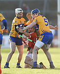 Robert O Shea of Cork  in action against Ryan Taylor, David Fitzgerald and Jack Browne (hidden) of Clare during their Munster Hurling League game at Cusack Park. Photograph by John Kelly.