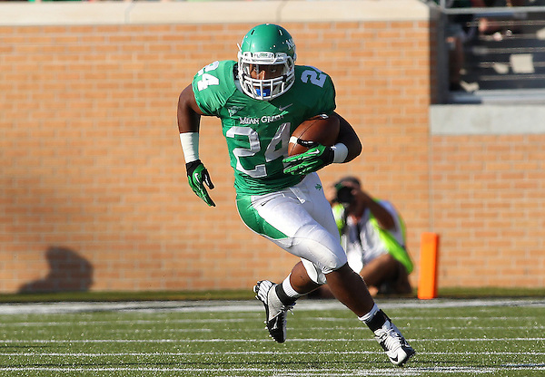 Denton, TX - NOVEMBER 3: Brandin Byrd #24 running back make a reception and runs against the Arkansas State Red Wolves of the North Texas Mean Green at Apogee Stadium in Denton on November 3, 2012 in Denton, Texas. Photo by: Rick Yeatts