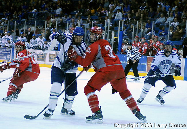 March 14, 2009:   Sacred Heart defender, Gregg Rodriguez (3), works against Jacques Lamoureux (21)as the Pioneers defeat the Air Force Falcons 4-1 and even their Atlantic Hockey Association playoff series at Cadet Ice Arena, U.S. Air Force Academy, Colorado Springs, Colorado.