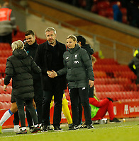 17th November 2019; Anfield, Liverpool, Merseyside, England; Womens Super League Footballl, Liverpool Women versus Everton; Everton manager Willie Kirk consoles Liverpool FC Women manager Vicky Jepson after his side secured a 1-0 win today