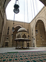 At the interior of the Mosque & School of Sultan Hassan it is found the ablution fountain surrounded by four iwans