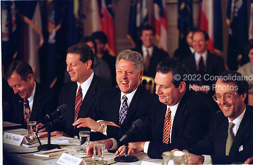 United States President Bill Clinton enjoys a light moment during the opening remarks of his meeting with the National Governors' Association in The East Room at The White House in Washington, D.C. on February 3, 1997. Pictured from left to right: Governor George Voinovich (Republican of Ohio), U.S. Vice President Al Gore, President Clinton, Governor Bob Miller (Democrat of Nevada), and White House Chief of Staff Erskine Bowles..Credit: Ron Sachs / CNP