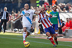 Atletico de Madrid´s Griezmann (R) and Deportivo de la Coruña´s Laure during 2014-15 La Liga match between Atletico de Madrid and Deportivo de la Coruña at Vicente Calderon stadium in Madrid, Spain. November 30, 2014. (ALTERPHOTOS/Victor Blanco)