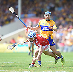 Sean O Donoghue of Cork in action against Shane O Donnell of Clare during their Munster senior hurling final at Thurles. Photograph by John Kelly.