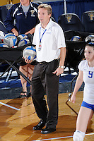 22 November 2008:  New Orleans Volleyball Head Coach Jozsef Forman watches his players during pre-game warm-ups prior to the WKU 3-0 victory over New Orleans in the championship game of the Sun Belt Conference tournament at U.S. Century Bank Arena in Miami, Florida.