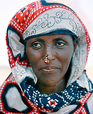 ERITREA, Saroita, portrait of an Afar man Mrs. Bedri in front of her home in the small village of Saroita