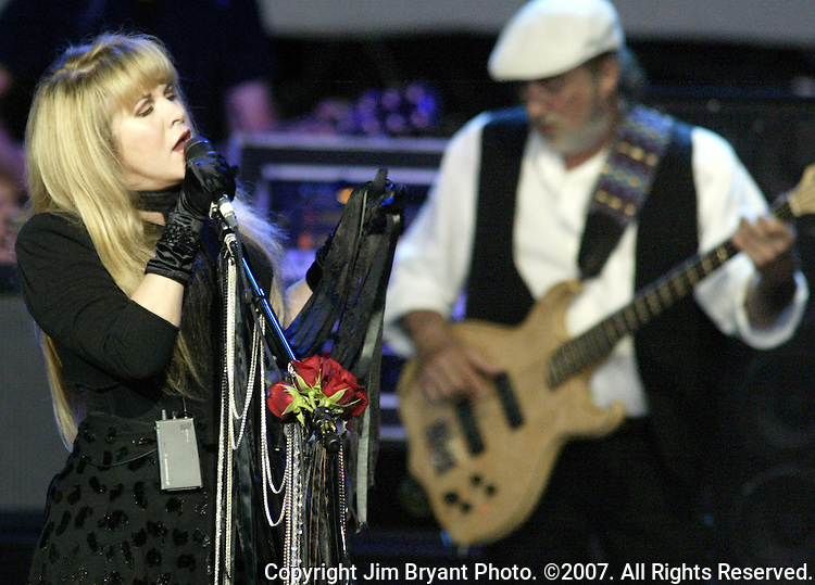 "Stevie Nicks belts out the lyrics to ""The Chain"" during the Fleetood Mac performance at the White River Amphitheatre in Auburn, WA., on July  1, 2004.  This is the 25th stop of their 35 city nationwide 2004 tour. Jim Bryant Photo. ©2004. All Rights Reserved."