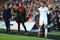 Martin Olsson of Swansea City is watched by Swansea City manager Paul Clement  during the Premier League match between Swansea City and Bournemouth at the Liberty Stadium, Swansea, Wales, UK. Saturday 25 November 2017