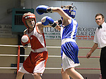 Adam Farrell (in red) from Ardee boxing Club and Sean O'Donoghue from Dealgan Boxing Club in action in the Louth Meath Boxing Championships held in Holy Family Boxing Club Ballsgrove.  Photo:Colin Bell/pressphotos.ie