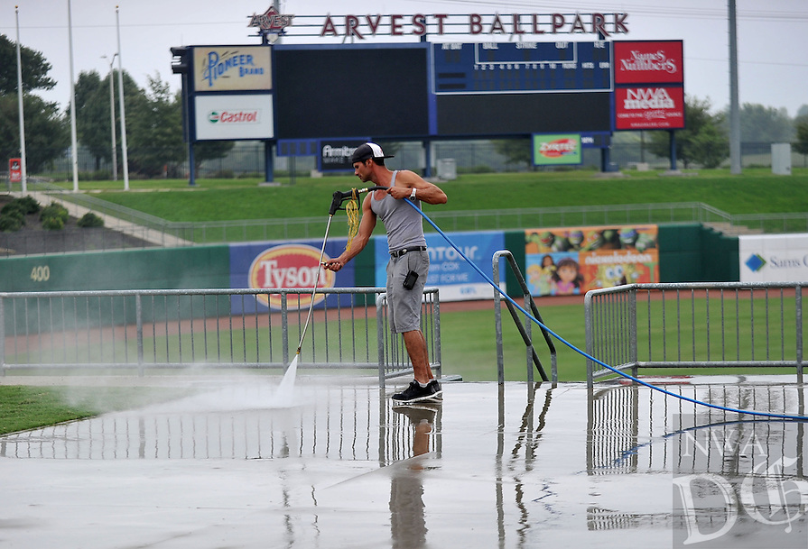 NWA Media/Michael Woods --09/16/2014-- w @NWAMICHAELW... Billy Taylor pressure washes the concourse on Arvest Ballpark Tuesday afternoon in Springdale as crews clean up the stadium for the season.  The Naturals finished their 2014 season with a record of 53 wins and 87 losses.