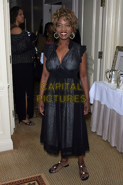ALFRE WOODARD.Archbishop Desmond Tutu Honored by Artists for a New South Africa for his 75th Birthday Celebration - Arrivals held at the Regent Beverly Wilshire Hotel, Beverly Hills, California, USA..September 18th, 2006.Ref: ADM/ZL.full length black sheer polka dot dress.www.capitalpictures.com.sales@capitalpictures.com.©Zach Lipp/AdMedia/Capital Pictures.