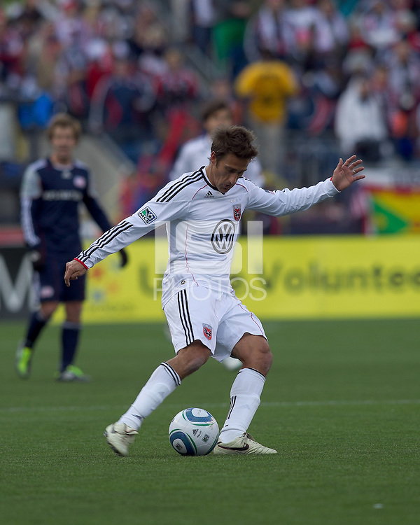 DC United forward Josh Wolff (16) passes the ball. In a Major League Soccer (MLS) match, the New England Revolution defeated DC United, 2-1, at Gillette Stadium on March 26, 2011.