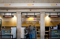 A traveler buy a train ticket at a VIA Rail Canada booth in Toronto Union station April 20, 2010.