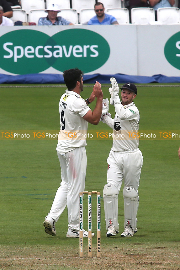 Kent bowler, Grant Stewart celebrates taking the wicket of Surrey's Rory Burns with wicketkeeper, Ollie Robinson during Surrey CCC vs Kent CCC, Specsavers County Championship Division 1 Cricket at the Kia Oval on 7th July 2019