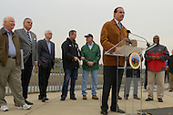 November 4, 2011  (Bladensburg, MD)  District of Columbia Mayor Vincent Gray (at podium) joined federal, state, and local officials to celebrate the recent completion of 12 miles of walking and biking trail in the District and 1.5 miles in Maryland.  As part of a larger system, both trails will eventually provide nearly 60 miles of continuous trails.  The Anacostia River Watersheds' project was also selected to stimulate local economies, create local jobs, and improve quality of life under the Urban Waters Federal Partnership.   (L-R)  U.S. Senator Ben Cardin (D-MD); Ray LaHood, U.S. Secretary of Transportation; Bob Perciasepe, EPA Deputy Administrator; Maryland Governor Martin O'Malley; Ken Salazar, U.S. Secretary of Transportation; Rashurn Baker, Prince George's County Executive (far right).      (Photo by Don Baxter/Media Images International)