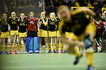 Berlin, Germany, January 31: Players of Harvestehuder THC look on during penalties shoot out during the 1. Bundesliga Damen Hallensaison 2014/15 semi-final hockey match between HTC Uhlenhorst Muehlheim (white/green) and Harvestehuder THC (black/yellow) on January 31, 2015 at the Final Four tournament at Max-Schmeling-Halle in Berlin, Germany. Final score 6-5 after penalties (3-1, 3-3, 3-3, 3-3). (Photo by Dirk Markgraf / www.265-images.com) *** Local caption ***