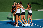 SURPRISE, AZ - MAY 11: Verena Schmid hugs Mara Cerrini, Judith Bohnenkamp and Sonja Larsen after their team's Championship title win against the West Florida Argonauts at the Division II Women's Tennis Championship held at the Surprise Tennis & Racquet Club on May 11, 2018 in Surprise, Arizona. (Photo by Jack Dempsey/NCAA Photos via Getty Images)