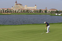 Alexander Levy (FRA) putts on the 6th green during Sunday's Final Round of the 2014 BMW Masters held at Lake Malaren, Shanghai, China. 2nd November 2014.<br /> Picture: Eoin Clarke www.golffile.ie