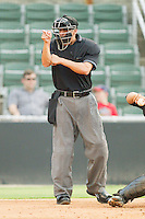 \Home plate umpire Derek Mollica makes a strike call during the South Atlantic League game between the Hickory Crawdads and the Kannapolis Intimidators at Fieldcrest Cannon Stadium August 18, 2010, in Kannapolis, North Carolina.  Photo by Brian Westerholt / Four Seam Images