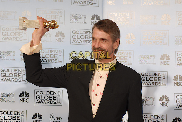 "JEREMY IRONS.Winner for Best Supporting Actor in Mini-Series Television Movie ""Elizabeth I"".Pressroom - 64th Annual Golden Globe Awards, Beverly Hills HIlton, Beverly Hills, California, USA..January 15th 2007. .globes press room half length award trophy black suit arm in air jacket.CAP/AW.Please use accompanying story.Supplied by Capital Pictures.© HFPA"" and ""64th Golden Globe Awards"""