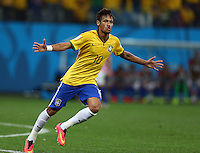 Neymar of Brazil celebrates scoring his goal to make the score 1-1