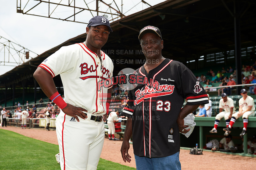 Birmingham Barons outfielder Courtney Hawkins (10) talks with former Negro League player Henry Elmore before the 20th Annual Rickwood Classic Game against the Jacksonville Suns on May 27, 2015 at Rickwood Field in Birmingham, Alabama.  Jacksonville defeated Birmingham by the score of 8-2 at the countries oldest ballpark, Rickwood opened in 1910 and has been most notably the home of the Birmingham Barons of the Southern League and Birmingham Black Barons of the Negro League.  (Mike Janes/Four Seam Images)