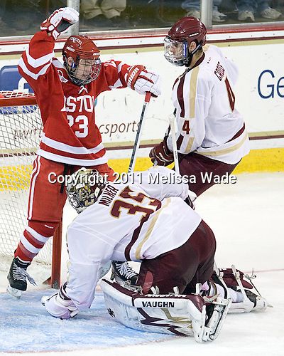 Cason Hohmann (BU - 23), Parker Milner (BC - 35), Tommy Cross (BC - 4) - The visting Boston University Terriers defeated the Boston College Eagles 5-3 (EN) on Friday, December 2, 2011, at Kelley Rink in Conte Forum in Chestnut Hill, Massachusetts.