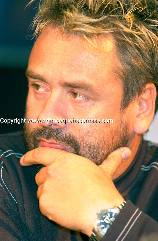 Aug 23, 2002, Montreal, Quebec, Canada<br /> <br /> <br /> Luc Besson, French Film Maker and Producer(R), at a press conference,for the movie<br /> LA TURBULENCE DES FLUIDES, that he co-produced Aug 23,  2002, in  Montreal, Quebec, Canada<br /> <br /> Besson directed many films including Leon, Nikita (Original version), the 5th Element,...<br /> <br /> <br /> Mandatory Credit: Photo by Pierre Roussel- Images Distribution. (&copy;) Copyright 2002 by Pierre Roussel <br /> <br /> NOTE : <br />  Nikon D-1 jpeg opened with Qimage icc profile, saved in Adobe 1998 RGB<br /> .Uncompressed  Uncropped  Original  size  file availble on request.