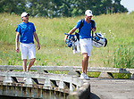 MUSCLE SHOALS, AL - MAY 25: West Florida's Christian Bosso walks across the bridge to the No. 9 tee box with Coach Steve Fell during the Division II Men's Team Match Play Golf Championship held at the Robert Trent Jones Golf Trail at the Shoals, Fighting Joe Course on May 25, 2018 in Muscle Shoals, Alabama. Lynn defeated West Florida 3-2 to win the national title. (Photo by Cliff Williams/NCAA Photos via Getty Images)
