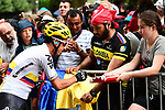 Sergio Henao (COL) Team Sky with fans at sign on before the start of Stage 9 of the 104th edition of the Tour de France 2017, running 181.5km from Nantua to Chambery, France. 9th July 2017.<br /> Picture: ASO/Alex Broadway | Cyclefile<br /> <br /> <br /> All photos usage must carry mandatory copyright credit (&copy; Cyclefile | ASO/Alex Broadway)