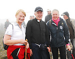 The Archbishop of Tuam Michael Neary arriving on the summit of Croagh Patrick, with his sister Helen and  Breege Cleary-Gibbons from Fanad Donegal ...Pic Conor McKeown