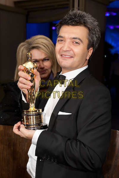 """Producer Thomas Langmann, winner of the Oscar® for Best Motion Picture of the Year for """"The Artist,"""".The Governors Ball following the 84th Annual Academy Awards® from Hollywood, CA., USA..February 26, 2012.*Editorial Use Only*.oscars half length black tuxedo trophy winner side .CAP/A.M.P.A.S./NFS.©A.M.P.A.S. Supplied by Capital Pictures. Oscars"""
