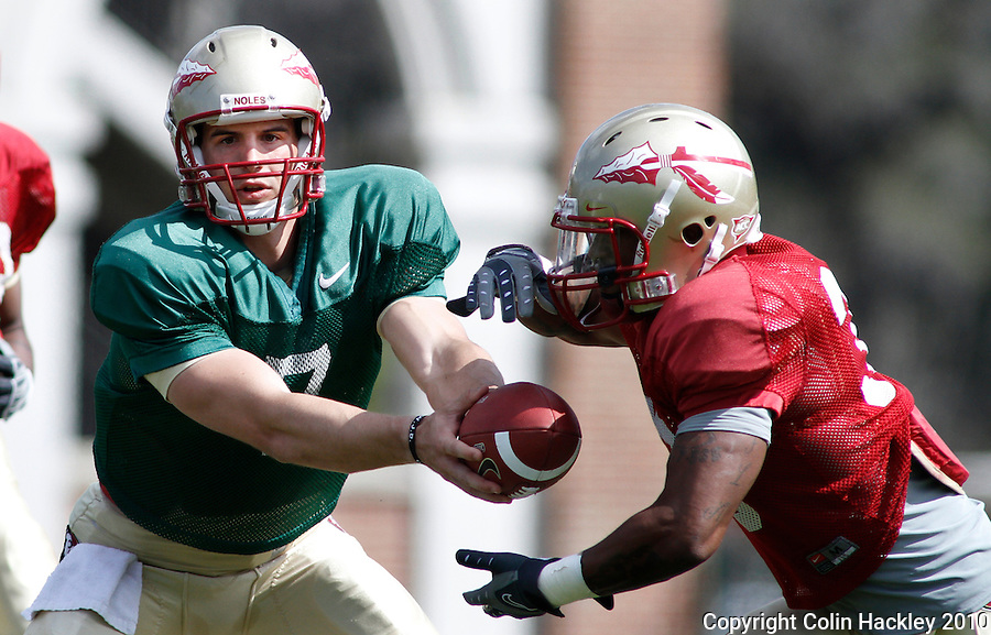 TALLAHASSEE, FLA.3/22/10-FSUFB32210 CH12-Florida State's Christian Ponder hands off to Tavares Pressley  during practice Monday in Tallahassee...COLIN HACKLEY PHOTO
