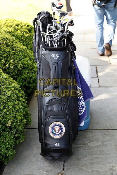As Aides unpack gear, United States President Barack Obama returns to the Oval Office after a Sunday afternoon of golf on Sunday, April 1, 2012.  .golf clubs .CAP/ADM/DB.©Dennis Brack/Pool/CNP/AdMedia/Capital Pictures.